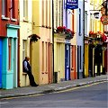 Man leaning on sill in Skibbereen, Cork