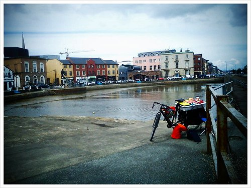 Crescent Quay, Wexford, painting it on a bicycle